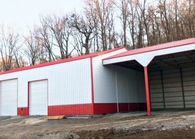 Photo of front of white and red pole barn